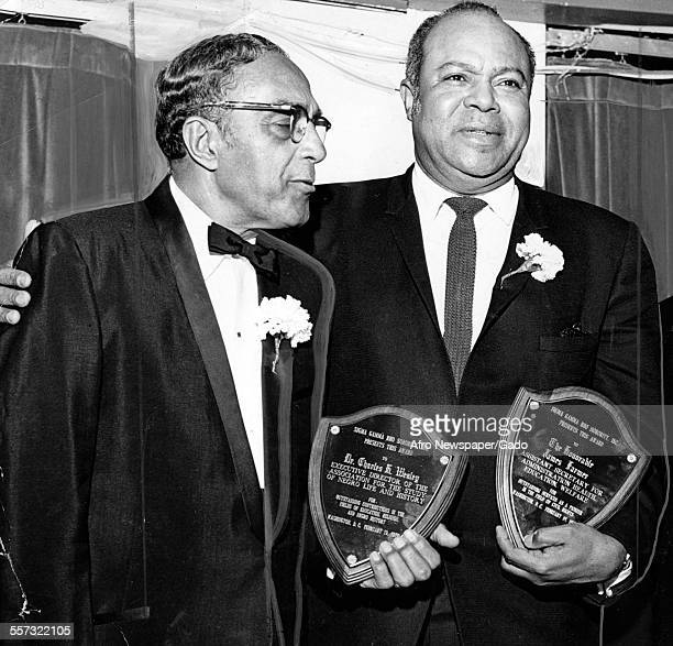 Dr Charles Wesley, executive director of the Association for the Study of Negro Life and History, and James Farmer, assistant secretary for...