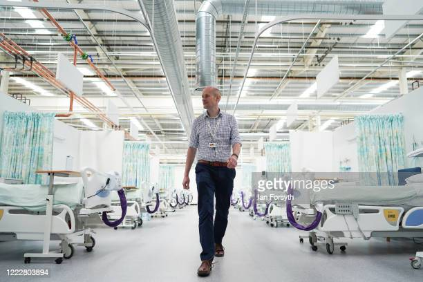 Dr Chris Johnson walks through ward 6 at the new NHS Nightingale North East hospital opened in response to the coronavirus pandemic on May 04 2020 in...