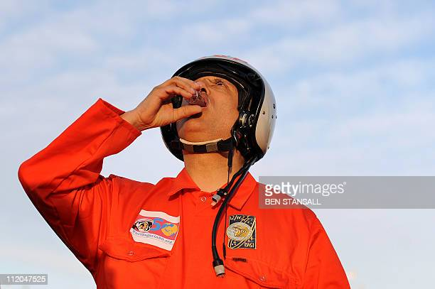 Dr Chris Welch drinks a toast of vodka before a walk to mark a half century since Russian cosmonaut Yuri Gagarin became the first man in space in...