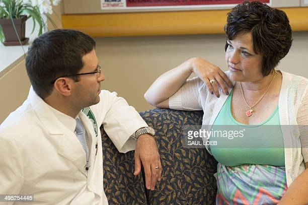 Dr Christian Hinrichs assistant clinical investigator at the Center for Cancer Research at the National Cancer Institute speaks alongside his patient...