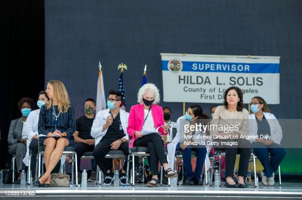 Dr. Christina Ghaly, director of the L.A. County Department of Health Services, left, Dr. Barbara Ferrer, director of the L.A. County Department of...