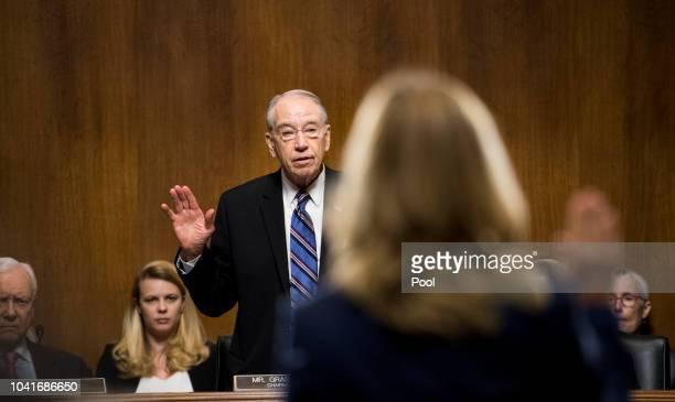 Dr. Christine Blasey Ford is sworn in by chairman Chuck Grassley, R-Iowa, on Capitol Hill September 27, 2018 in Washington, DC. A professor at Palo...