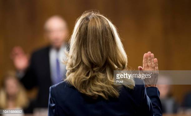 Dr Christine Blasey Ford is sworn in by chairman Chuck Grassley RIowa on Capitol Hill September 27 2018 in Washington DC A professor at Palo Alto...
