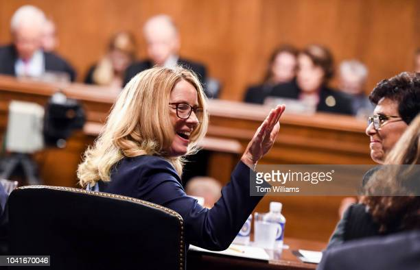 Dr Christine Blasey Ford takes her seat to testify on Thursday Sept 27 during the Senate Judiciary Committee hearing on the nomination of Brett M...