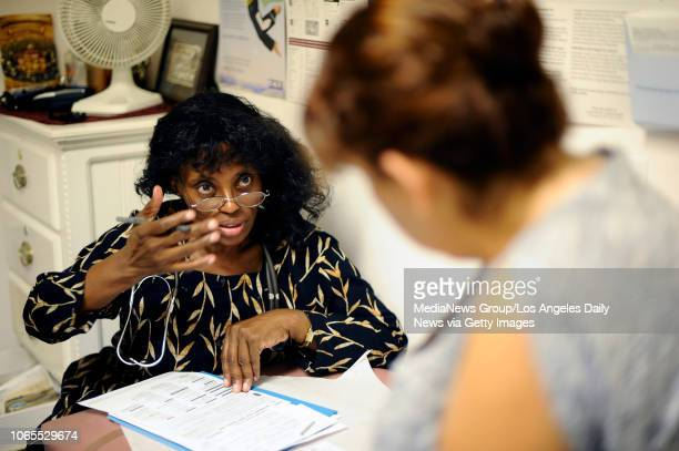 Dr Christine Daniel talks to patient Amparo Villaluazo at Daniel's Sonrise Medical Clinic in Mission Hills on September 29 2001 Daniel of Northridge...