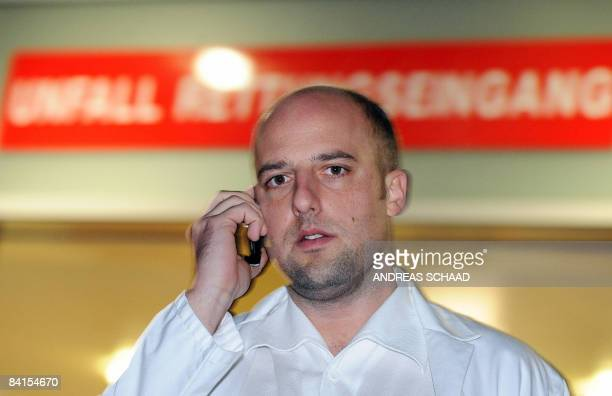 Dr. Christoph Kollersbeck, a member of the hospital of Schwarzach, Austria speaks on a phone on January 1, 2009 after the Premier of the central...