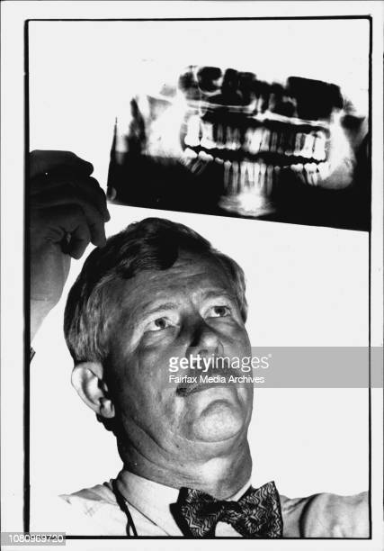 Dr Christopher Griffiths Forensic dentist with an X ray of teeth from one of the hitchhikers found murdered at BowralAdvocating a registry of dental...