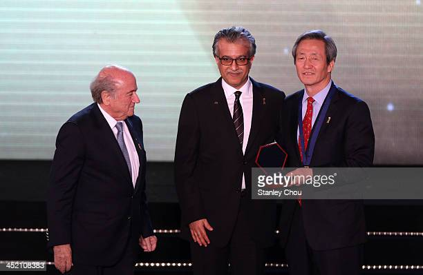 Dr Chung Mongjoon receives the AFC Diamond of Asia award from Sheikh Salman bin Ibrahim Al Khalifa the AFC President while Joseph S Blatter the FIFA...