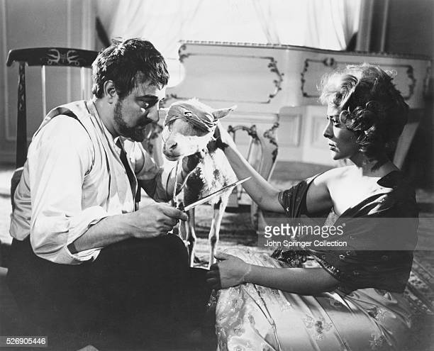 Dr Comte and Leticia prepare to slaughter a goat in a scene from the 1962 film El Angel exterminador