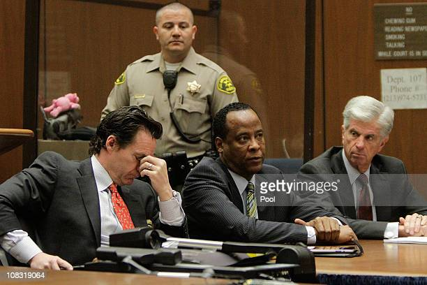 Dr Conrad Murray appears in court with defense attorneys Edward M Chernoff and John Michael Flanagan for an arraignment hearing on January 25 2011 in...