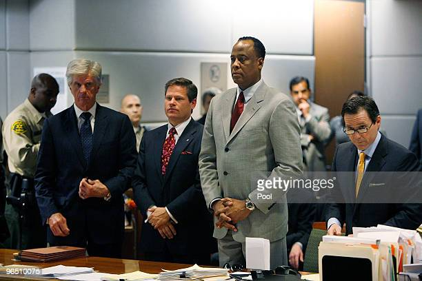 Dr Conrad Murray his attorney Ed Chernoff and defense team members stand before Los Angeles Superior Court Judge Keith L Schwartz as Murray is...