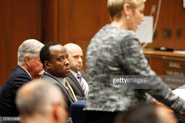 Dr Conrad Murray watches prosecutor Deborah Brazil question concert promoter Paul Gongaware on the second day of his involuntary manslaughter trial...