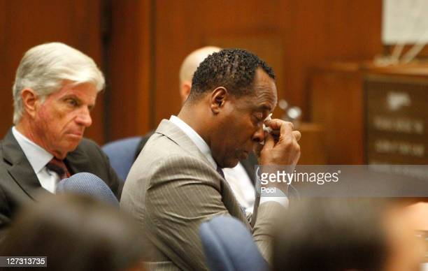 Dr Conrad Murray wipes a tear during the defense opening arguments in his involuntary manslaughter trial at the Los Angeles Superior Court on...