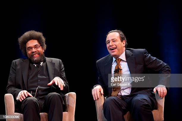 Dr Cornel West and David Frum share a laugh as panelists at Tavis Smiley's 'America's Next Chapter' on January 13 2011 in Washington DC