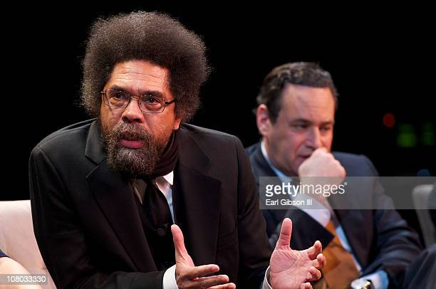 Dr Cornel West shares his views while David Frum listens at the Tavis Smiley panel 'America's Next Chapter' on January 13 2011 in Washington DC