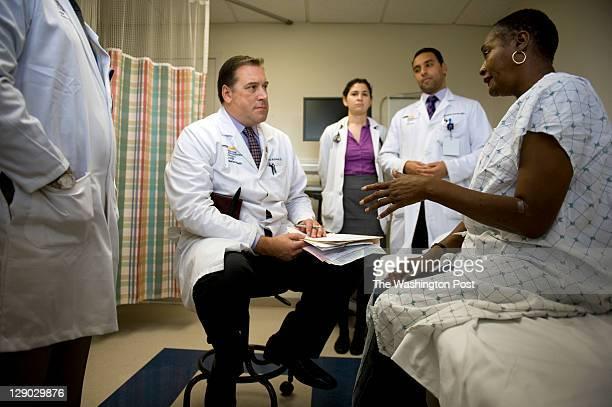 Dr. Curtis Whitehair, med student Ann Lichtenstein and resident Dr. Christopher Karam listen to cancer patient Angela Milhouse during her checkup at...