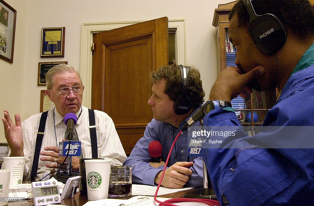 Dr. DA Henderson, left, talks about chemical warfare issues with radio host Jimmy Malone, right, and Rep. Sherrod Brown (D-FL), center, in Brown's office Tuesday morning.
