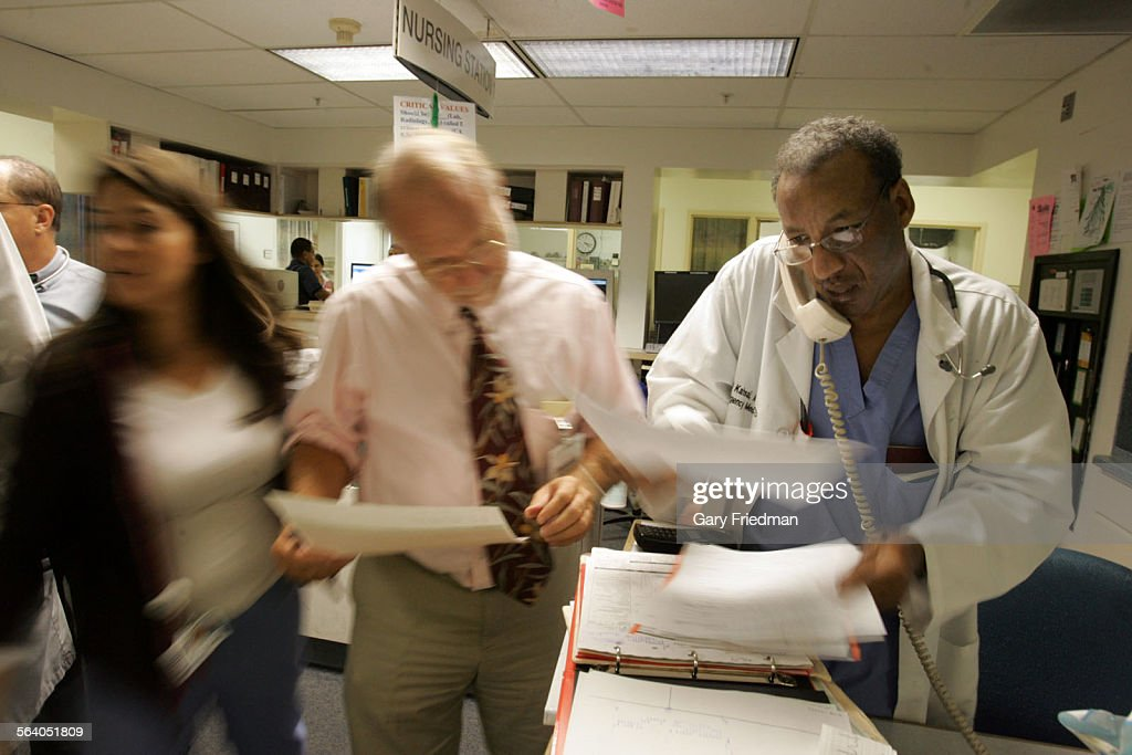 Dr. Daniel Kahsai (right) Dr. Richard Guess (middle), who is the ...