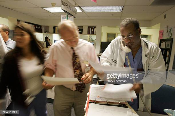 Dr Daniel Kahsai Dr Richard Guess who is the Medical Director Emergency Services inside a busy emergency room at the Downey Regional Medical Center...