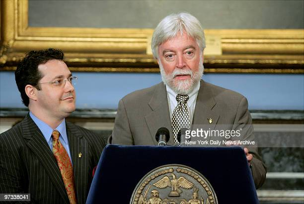 Dr David Staffenberg looks on as Dr James Goodrich speaks at City Hall where they received the Mayor's Award of Excellence in Science and Technology...