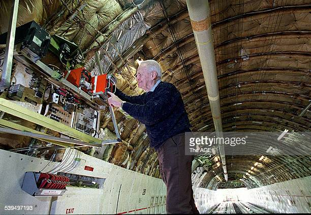 Dr David Warren inventor of the Black Box flight recorder checks one of the devices on a 747 cargo plane at Melbourne Airport 26 August 1998 THE AGE...