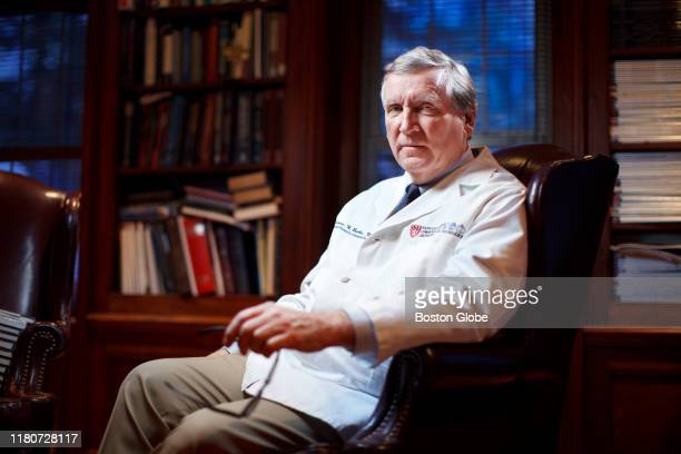 Dr Dennis Burke former orthopedic surgeon at Massachusetts General Hospital poses for a portrait at his home in Milton MA on Feb 19 2015 Burke came...