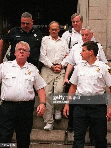 Dr Dirk Greineder is escorted out of the courthouse at Norfolk Superior Court in Dedham Mass on June 29 moments after he was convicted of of...
