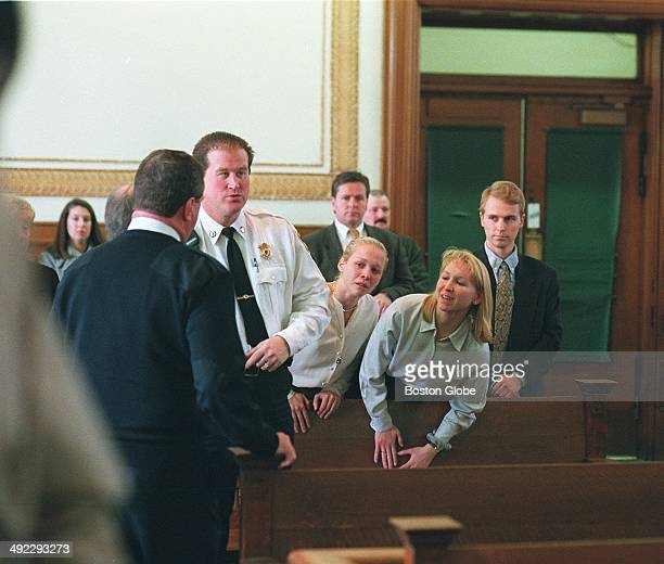 Dr Dirk Greineder of Wellesley accused of murdering his wife is led past his children Britt Kirsten and Colin during arraignment at Norfolk Superior...