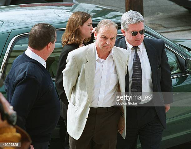 Dr Dirk Greineder of Wellesley accused of murdering his wife is led into Norfolk Superior Court in Dedham Mass fork arraignment on March 1 2000...