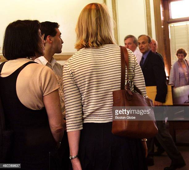 Dr Dirk Greineder walks past his son Colin second from left and daughter Britt center standing with a family friend left as he leaves the courtroom...