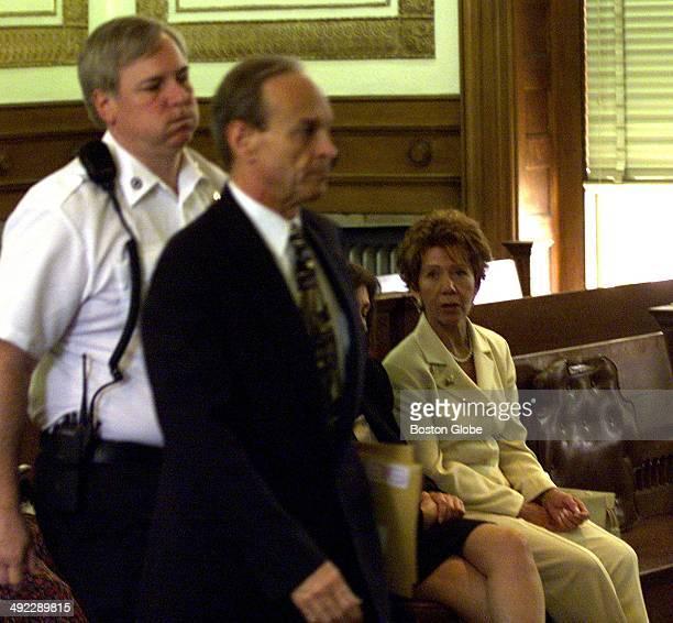Dr Dirk Greineder walks past Ilse Stark sister of Mabel Greineder who was murdered during the trial at Norfolk Superior Court on June 6 2001...