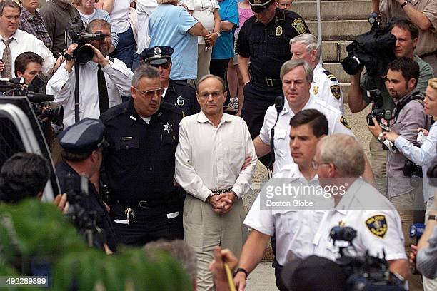 Dr Dirk K Greineder an allergist at Brigham and Women's Hospital is escorted from Norfolk Superior Court in Dedham Mass on June 29 after being...
