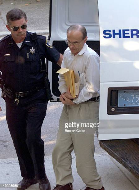 Dr Dirk K Greineder makes his way into Norfolk Superior Court in Dedham Mass on the morning of June 28 2001 Greineder an allergist at Brigham and...