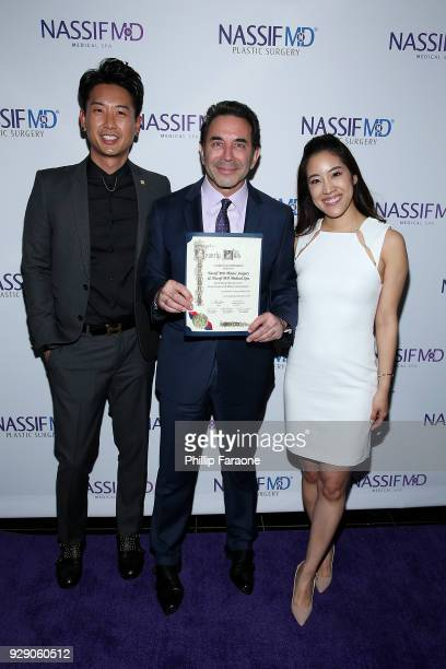 Dr Donald Yoo Dr Paul Nassif and Dr Grace Lee Peng arrive for Dr Paul Nassif's unveiling of his new medical spa with grand opening and ribboncutting...