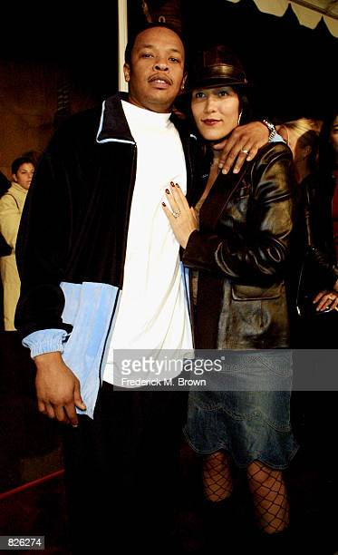 Dr Dre and his wife Nicole Young attend the film premiere of The Wash November 12 2001 in Los Angeles CA