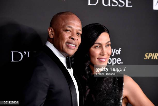 Dr Dre and Nicole Young attend the City of Hope Spirit of Life Gala 2018 at Barker Hangar on October 11 2018 in Santa Monica California