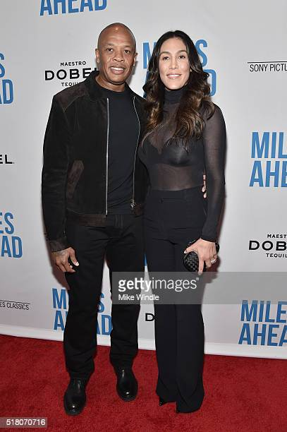 Dr Dre and Nicole Young attend the premiere of Sony Pictures Classics' 'Miles Ahead' at Writers Guild Theater on March 29 2016 in Beverly Hills...