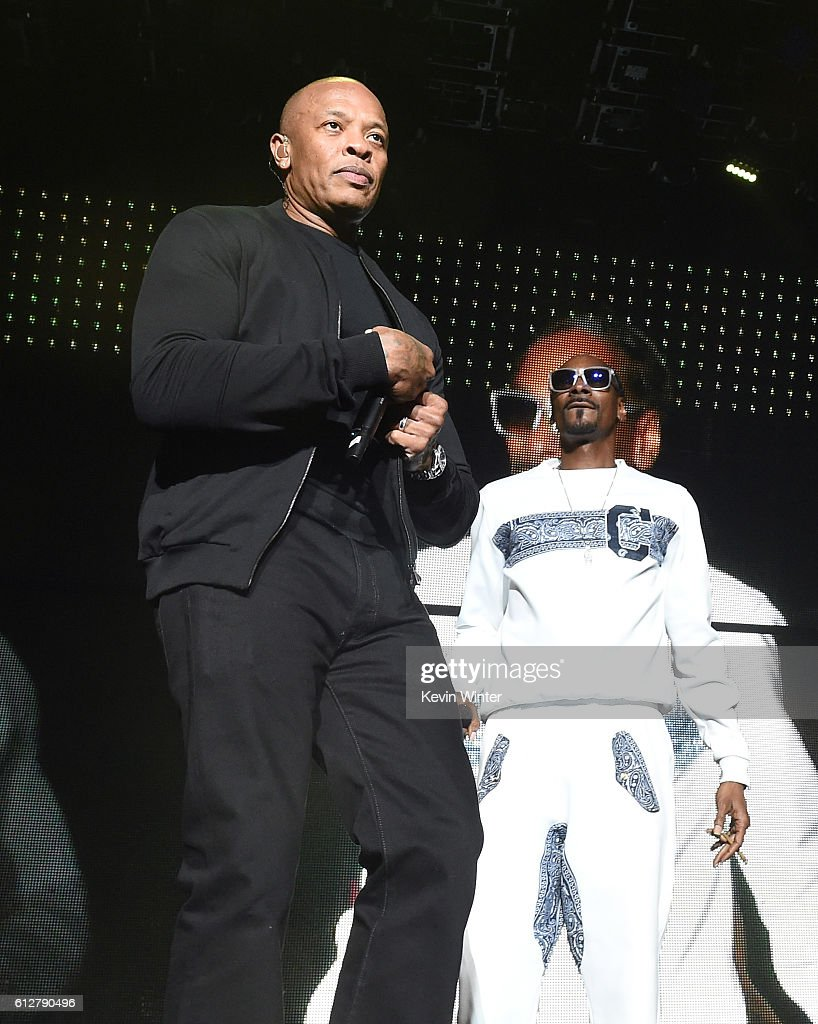 Dr. Dre (L) and Snoop Dogg perform onstage during the Bad Boy Family Reunion Tour at The Forum on October 4, 2016 in Inglewood, California.