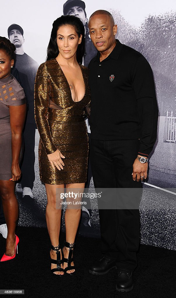 Dr. Dre (R) and wife Nicole Young attend the premiere of 'Straight Outta Compton' at Microsoft Theater on August 10, 2015 in Los Angeles, California.