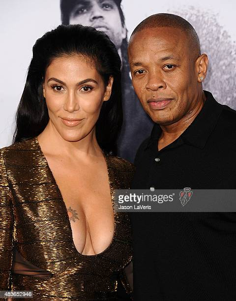 Dr Dre and wife Nicole Young attend the premiere of Straight Outta Compton at Microsoft Theater on August 10 2015 in Los Angeles California