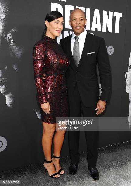 Dr Dre and wife Nicole Young attend the premiere of The Defiant Ones at Paramount Theatre on June 22 2017 in Hollywood California