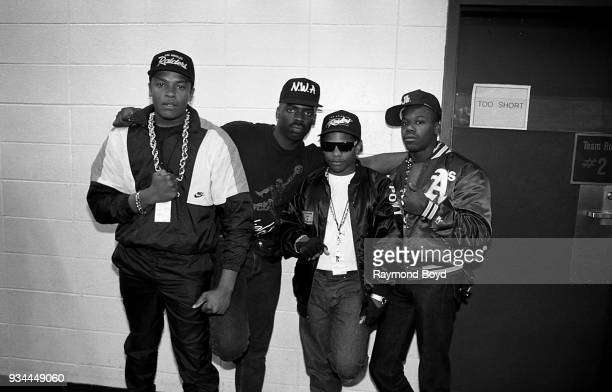 Dr Dre comedian TK Kirkland rapper EazyE from NWA and rapper Too Short poses for photos backstage during the 'Straight Outta Compton' tour at Market...