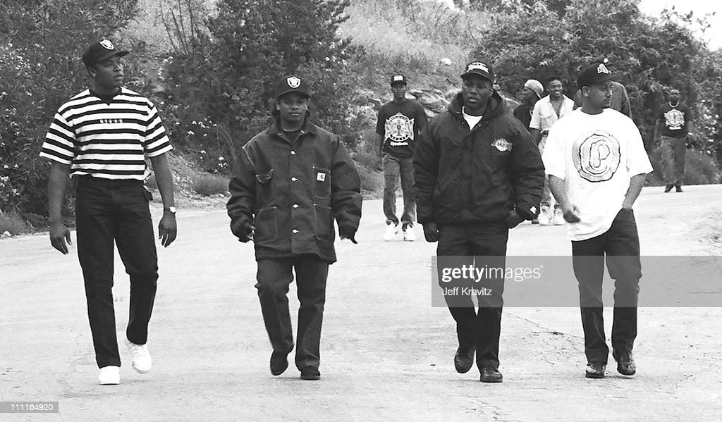 Dr. Dre, Eazy E during Yo MTV Taping of 'We're All In The Same Gang' Video Shoot at Elysian Park in Los Angeles, CA, United States.