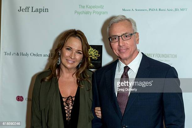 Dr Drew Pinksky and his wife arrives for the 42nd Annual Maple Ball at The Montage Hotel on October 26 2016 in Beverly Hills California