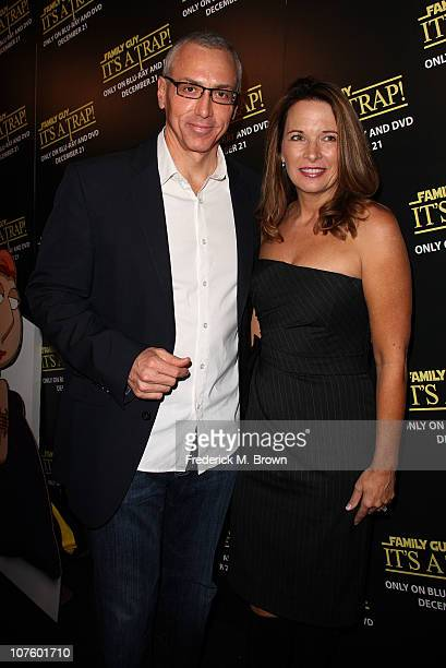 Dr Drew Pinsky and his wife attend the Family Guy It's a Trap DVD release party at the Supperclub on December 14 2010 in Los Angeles California