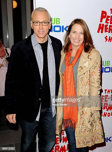 Dr Drew Pinsky and his wife Susan arrive at the opening night of The Peewee Herman Show in Club Nokia at LA Live on January 20 2010 in Los Angeles...