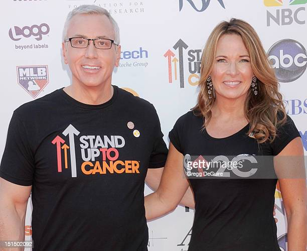 Dr Drew Pinsky and his wife Susan Pinsky arrive at Stand Up To Cancer at The Shrine Auditorium on September 7 2012 in Los Angeles California