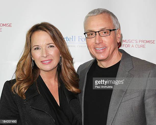 Dr Drew Pinsky and his wife Susan Pinsky attend the TJ Martell foundation's 3rd annual artworks for the cure charity event at Barker Hangar on...