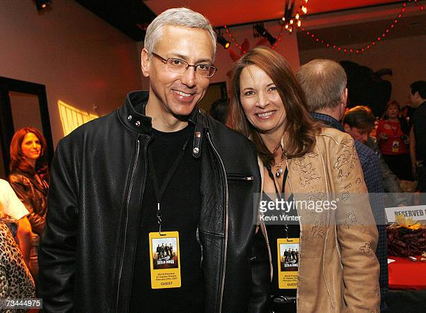 Dr Drew Pinsky and his wife Susan pose at the afterparty for the premiere of Touchstone Picture's Wild Hogs at the Annex on February 27 2007 in Los...