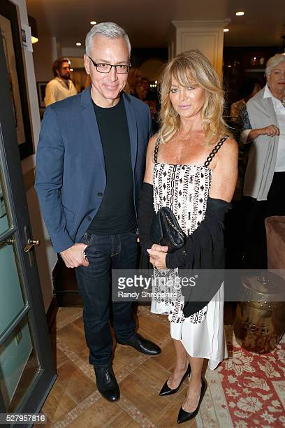 Dr Drew Pinsky and honoree Goldie Hawn attend Russell Simmons' Rush Philanthropic Arts Foundation's inaugural Art For Life Los Angeles at Private...